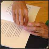 Hand Sewing the Book's Signatures.